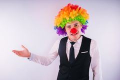 Office worker in clown wig, clown concept at work. Businessman with clown wig on white royalty free stock photos