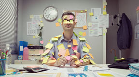 Office worker covered with stick notes Stock Photos