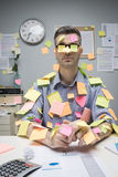 Office worker covered with stick notes Royalty Free Stock Photography