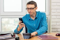 Office worker dials the phone number. Office worker dials the phone  number royalty free stock image