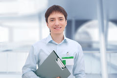 Office worker with document folder. Royalty Free Stock Images