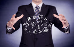 Office worker with drawn icons in the palm Royalty Free Stock Photo