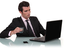 Office worker drinking water Royalty Free Stock Photo