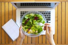 Free Office Worker Eating A Takeaway Salad At Work. Concept Of Healthy Eating At Work. Stock Image - 184479741