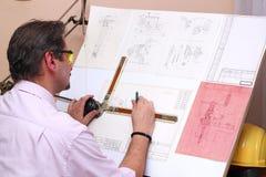 Office Worker - Engineer. Engineer working on blueprint Stock Image