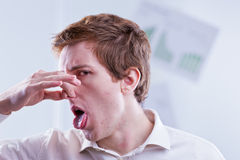 Office worker expresses his total disappointment. Pinching his nose Stock Photos