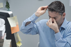 Office worker with eye pain Royalty Free Stock Photo