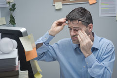 Office worker with eye pain Stock Images