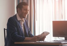 Office worker is feeling optimistic after reading motivational book. Office worker is feeling optimistic after reading a motivational book Royalty Free Stock Images