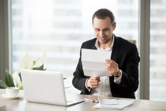 Office worker gets pay raise, premium or bonus Stock Photography