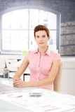 Office worker girl at desk Royalty Free Stock Images