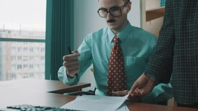 Office worker in glasses, fake mustaches mechanically signs documents, as robot stock footage