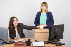 Office worker happily helps collect things sacked colleague Stock Photo