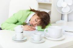Office worker has fallen asleep despite Royalty Free Stock Image