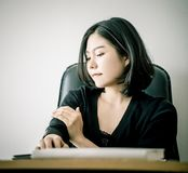 Office worker having injury on her arm from office health problem royalty free stock image