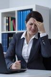 Office worker having migraine Stock Images