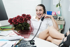 Office worker having a romantic call Royalty Free Stock Images