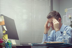 Office worker with headache Royalty Free Stock Image