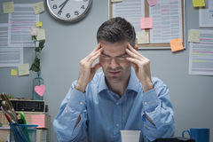 Office worker with headache Stock Photo
