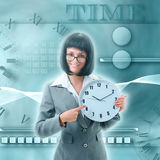 Office worker  holding big clock Royalty Free Stock Photo