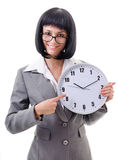 Office worker  holding big clock Stock Photo