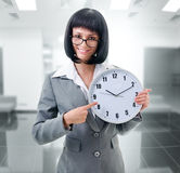 Office worker  holding big clock Stock Photos