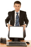 Office worker holding blank computer monitor with clipping path Stock Image
