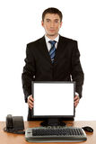 Office worker holding blank computer monitor with clipping path Stock Photo