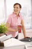 Office worker holding coffee to go Royalty Free Stock Photo