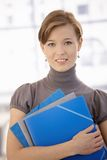 Office worker holding folders Royalty Free Stock Photos
