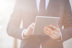Office worker holding tablet Royalty Free Stock Images