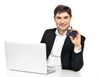 Office worker with  laptop and credit card Royalty Free Stock Image