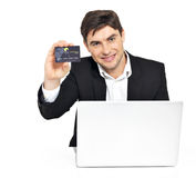 Office worker with  laptop and credit card Royalty Free Stock Photo