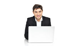 Office worker with  laptop sitting on the table Royalty Free Stock Images