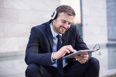 Office worker listening music Royalty Free Stock Image