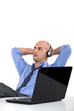 Office worker listening to music Royalty Free Stock Photos
