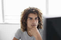 Office Worker Looking At Computer Monitor Stock Photos