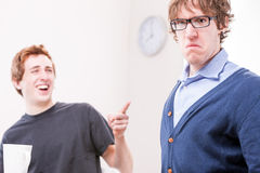 Office worker makin fun of his colleague Stock Image