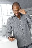 Office worker with mobile phone Royalty Free Stock Photo