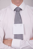 Office worker with note on tie Royalty Free Stock Photo