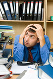 Office worker overworked Stock Images