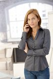 Office worker on phone call Stock Image