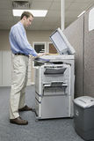 Office worker photocopying royalty free stock images