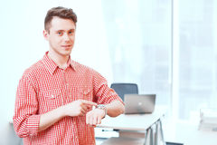 Office worker pointing on his watch Royalty Free Stock Photos