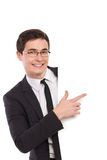 Office worker pointing at white banner. Young man in black suit pointing at the banner. Three quartet length studio shot isolated on white Stock Images