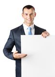 Office worker points at paper copy space Stock Image