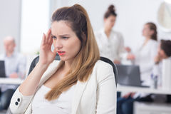 Office worker with pregnancy symptoms Royalty Free Stock Photography