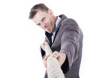 Office worker pulling a rope Royalty Free Stock Photography