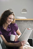 Office worker reading magazine Stock Image