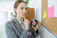 Office worker reading notes. Office worker reading the notes royalty free stock images